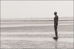 Another Place (FlickrDelusions) Tags: blackandwhite bw liverpool sculptures antonygormley anotherplace crosbybeach