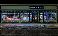 A Mercantile Christmas (Russ Allison Loar) Tags: christmas street winter storm cold ice up weather shop rural snowflakes store michigan snowstorm freezing christmaslights christmasdecorations isolation nightscene snowfall blizzard frigid coldweather climatechange smalltown snowplow winterstorm snowedin winterweather weatherreport calumet yooper winterlandscape snowpack northernmichigan greatwhitenorth christmaswindows snowyweather neighborhoodsnow houseinsnow eveningsnow uppermichiganpeninsula