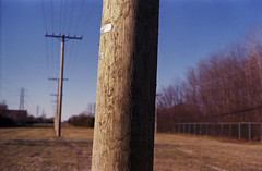 Untitled (Armin Schuhmann) Tags: auto wood old trees canada color film grass electric analog 35mm vintage fence lens outdoors prime haze wire focus fuji dof post quebec bokeh superia montreal f14 uv ishootfilm scan pole mc automn negative 55mm hydro filter 400 pelicula normal analogue manual filme fujica st705 400asa argentique filmscan chinon planar analogic xtra selfdeveloped c41 filmphotography 2015 unicolor shootfilm filmphoto filmisnotdead heliopan analogo believeinfilm buyfilmnotmegapixels