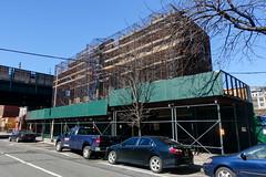another one bites the dust (nicknormal) Tags: newyork us construction scaffolding unitedstates hoarding scaffold gentrification longislandcity
