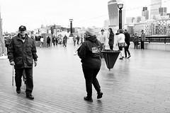 Armed with knowledge (lorenzoviolone) Tags: england blackandwhite bw london monochrome thames river blackwhite skyscrapers riverside unitedkingdom strangers streetphotography finepix fujifilm streetphoto riverthames queenswalk skygarden agfascala200 mirrorless vsco streetphotobw vscofilm fujix100s x100s fujifilmx100s travel:uk=londonapr16