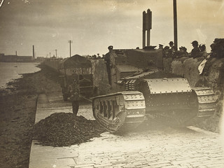 Tank pulling three ton Military truck from the banks of the Liffey