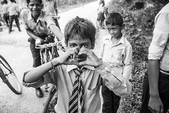 (milan syangbo) Tags: street school nepal love students monochrome pose blackwhite kid eyecontact streetphotography gesture blackdiamond streetshot canon7d