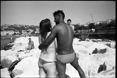 (Summer of Love, 2016) (Robbie McIntosh) Tags: leica boy blackandwhite bw woman man love film girl monochrome analog 35mm seaside rocks candid 28mm strangers streetphotography rangefinder bn lovers negative mp analogue speedos biancoenero argentique dyi selfdeveloped agfaapx100 pellicola elmarit analogico leicamp leicam filmisnotdead autaut lidomappatella leicaelmarit28mmf28iii mappatellabeach agfaphotoapx100 elmarit28mmf28iii arsimagofd arsimagofddeveloper arsimagofd159