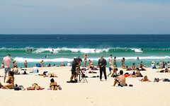 Vacation time - Sand, Sun, Surf, Beach and... Action!!!!! (JohnNguyen0297) Tags: street camera travel bondi shot sony sydney reporter sunny australia streetscene scene surfing sunbath suntan sands bondibeach tanning cameraman 18105 a6000 ilce6000 selp18105