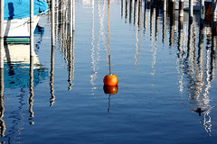 signals (Wackelaugen) Tags: water reflection lake lakeconstance bodensee germany harbour sailing boats buoy orange canon eos photo photography wackelaugen googlies