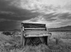 Forgotten Melody (JasonCameron) Tags: old bw white storm black monochrome field rain weather clouds mono antique piano abandon elements behind left dilapidated ruined