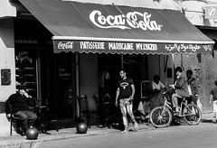 It's the real thing. (Johnbasil1) Tags: bw bicycle shop locals coke morocco marrakech fujifilm shoppers xe1