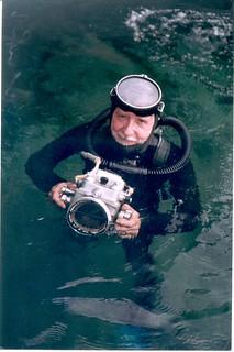Vintage double hose scuba diver with camera.