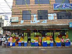 Three Fruit Stalls (karlahovde) Tags: street travel orange color apple horizontal fruit shopping pattern pyramid market pomegranate stall vegetable symmetry round vendor dhaka shape grape bangladesh bazar repeating