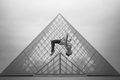 (dimitryroulland) Tags: street city urban white black paris france art jump nikon circus 85mm gymnast gymnastics 18 gym performer pyramide lelouvre d600 dimitry roulland