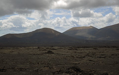 The Badlands (Preston Ashton) Tags: clouds landscape volcano cloudy bad hills badlands lands volcanic prestonashton