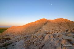 Toadstool Moon (kevin-palmer) Tags: toadstool toadstoolgeologicalpark crawford nebraska oglalanationalgrassland june summer nikond750 badlands highplains clear sunny blue sky sunlight waxinggibbous moon evening sunset dusk tokina1628mmf28