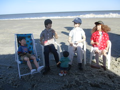 Story Time (larry_boy17) Tags: ocean people beach water hat children toy outside toys outdoors actionfigure coast sand doll surf dolls shadows action brothers outdoor brother tide ken barbie harry potter harrypotter tommy clothes plastic shore shade actionfigures figure figures mattel hermione starace bratzboyz