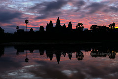 Morning Prelude (pdxsafariguy) Tags: buddhism travel cambodia architecture ruin temple building tower sunrise stone reflection sky hinduism lake dawn cloudscape religion monument asia archaeology civilization clouds southeastasia tree water angkorwat siemreap unesco khmer silhouette tomschwabel