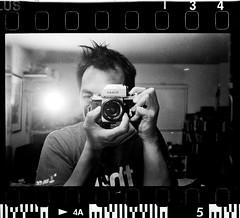 Self Portrait (Alien Light Beam) Tags: camera old school portrait white black film me self mirror nikon focus kodak grain hc110 delta iso negative f scanned plus epson hp5 manual v600 development ilford v800 mirroe ehite elmusion