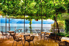 Restaurant Tables on a Patio Under a Trellis (George Oze) Tags: travel summer italy lake mountains horizontal table outdoors europe view terrace relaxing scenic trellis patio lakeshore romantic daytime serene lakeview quaint lakecomo atmospheric emptytables varenna shaded lombardy northernitaly restauranttable provinceofcomo chairsandatables