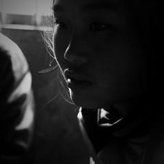 A farm girl, Guizhou, China (a.pierre4840) Tags: china portrait blackandwhite bw monochrome dof noiretblanc olympus depthoffield squareformat guizhou omd 25mm schneider kreuznach f19 em5 cmount xenoplan