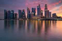Burning Facades (bing dun (nitewalk)) Tags: bridge sunset night marina bay singapore cityscape jubilee esplanade fujifilm cbd fullerton merlion x70 mbs