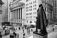 george washington overlooking the new york stock exchange (twurdemann) Tags: city newyorkcity people urban blackandwhite newyork statue architecture bronze buildings unitedstates crowd pantheon streetphotography tourists financialdistrict wallstreet capitalism georgewashington sculptures pediment lowermanhattan banks neoclassical nyse federalhall broadstreet portico newyorkstockexchange corinthiancolumns johnquincyadamsward streetvendors foodcart pilasters georgepost classicalrevival integrityprotectingtheworksofman niksilverefex georgianmarble xf14mm fujixt1 2016tripnewyork naussastreet