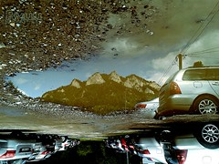 world turned upside down... (Ryuu) Tags: reflection puddle mountains water surface cars wheels tires lines parked wehicles ground earth stones reflecting mountain landscape upsidedown perspective sky clouds cloudy afterrain summer vacations lowpov 3crowns pieniny