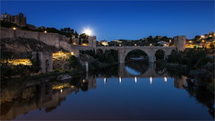 Moon is rising in Toledo / Spain 2016 (zilverbat.) Tags: spanje bluehour zilverbat longexposurebynight image travel longexposure innercity bridge brucke brug nightphotography night nightshot nightlights visit tripadvisor hotspot unesco unescoheritage reflections reflectie toledo spain architecture avondfotografie availablelight moon lights landscape bookcover cover towers extremadura tagus rustic river tourism tourisme blue labour ngc puentedesanmartin arch archbridge gothic monument
