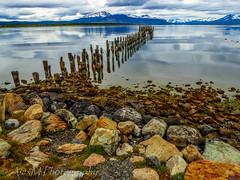 Skeleton of a pier (The Happy Traveller) Tags: patagonia parquenacionallosglaciares torresdelpaine lake puertonatales reflections