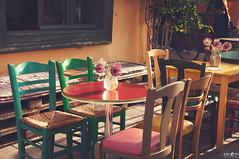 24 Cafe (kana movana) Tags: nafplion nafplio greece greek europe european d90 cafe restaurant house wall window street chair table vase decoration wooden colorful colors beautiful flower flowerpot old town architecture traditional