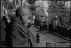 Monk with Tea (chinese johnny) Tags: nepal kathmandu film trix 35mm scannednegatives 35mmfilm blackandwhitefilm bwfilm analog blackandwhite monochrome boudhanath kathmanduvalley flickrunitedaward