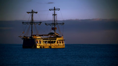 About pirates (Israel DeAlba) Tags: ocean blue sea clouds golden ship pirate nwn israeldealba