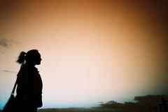 feel the breeze (fotobes) Tags: sunset portrait sky woman cloud silhouette bag sussex lca lomography dusk profile jess ponytail analogue vignette ditchlingbeacon fotobes lomochrometurquoise lomochrometurquoisexr100400
