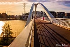 Isoisn silta II (Joni Salama) Tags: bridge blue sunset sea sky orange water photoshop suomi finland helsinki fi meri vesi ilta lightroom valo auringonlasku sininen arkkitehtuuri uusimaa silta oranssi taivas kalasatama on1effects isoisnsilta