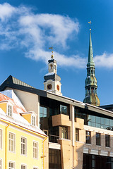 Town hall clock and St. Peter in Riga in winter (Viktor Descenko) Tags: christmas old city travel roof winter people urban house snow building tower history tourism church monument st architecture night square town hall ancient europe exterior cathedral outdoor famous decoration landmarks landmark baltic historic latvia countries peter peters riga locations blackheads