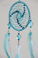 Dreamcatcher with phosphorescent beads (Shurik_Viola) Tags: blue sea beads aqua handmade turquoise teal feather craft ring bleu creation fantasy handcrafted spiritual boho decor ethnic gypsy homedecor handwork artisan dcoration bluegreen americanindian dreamcatcher plumes coq anneau objets glassbeads sources artisanat clairage spirituel cration ronde amerindian personnages perles amrindien fantaisie dreamcatchers bohme faitmain ethnique faitmaison perlesenverre lumireartificielle attraperves bluevert profotod1air500 modeleurs acquisitionimages shurikviola parpluieblancphotoflex