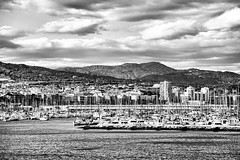 from the Lighthouse (explored 2016/05/04) (Fnikos) Tags: city sea sky blackandwhite nature water monochrome skyline architecture sailboat forest port landscape boat outdoor