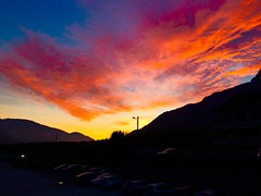 MyBestSunset. (Fabio Scalvinoni.) Tags: november autumn sunset red sky orange cloud sun mountain cold reflection love beautiful car night landscape photography evening photo remember afternoon shot cloudy bluesky snap mybest iphone lovethis iphone365