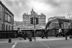 Coming and Going (Philip Gillespie) Tags: edinburgh scotland waverley stations travel trains mono black white luggage people men woman hotel station