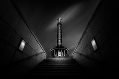 The Dark Side of Victory (One_Penny) Tags: city longexposure sky urban blackandwhite bw white black building berlin blancoynegro statue architecture angel clouds stairs canon germany dark deutschland photography lights view perspective wideangle victory symmetry illuminated capitol lowkey canonef1740mmf4lusm tiergarten siegessäule 6d victorycolumn ndfilter schwarzweis canon6d groserstern findeart