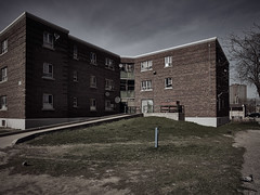 (StephenCaissiePhoto) Tags: sky urban toronto building brick architecture clouds spring afternoon lawn sunny wideangle housing desaturated slum brutalist relic antiquated lowangle walkup
