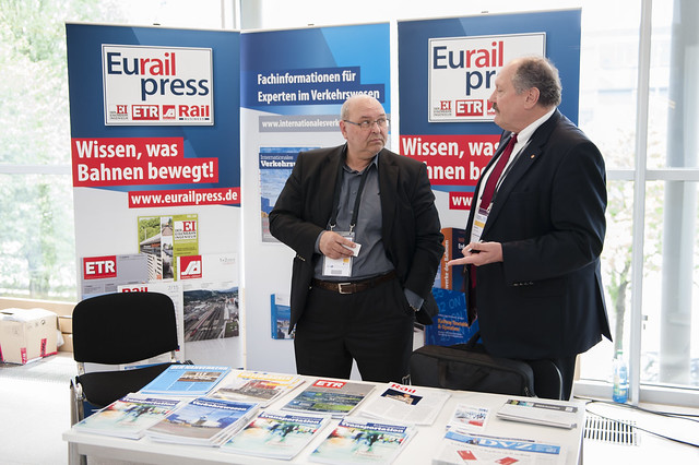 "Eurail Press representatives in discussion at the 2015 Exhibition taking place at the International Transport Forum's 2015 Summit on ""Transport, Trade and Tourism"" in Leipzig, Germany between 27-29 May 2015."