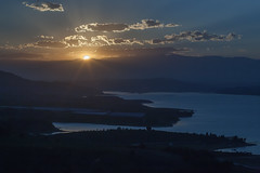 For whom  the sun rises / sets (Mustafa Karaoglu) Tags: sunset sun lake clouds sunrise sunrays adana seyhan seyhanlake