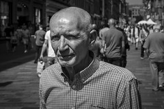 Catch The Sun (Leanne Boulton) Tags: life street city uk light shadow portrait people urban blackandwhite bw sunlight white man black detail male texture monochrome face look closeup canon 50mm mono scotland living blackwhite eyes eyecontact shadows natural emotion skin humanity outdoor expression glasgow candid character extreme culture streetphotography streetlife scene human shade portraiture 7d feeling society f8 depth tone facial suspicion candidportrait candidstreetphotography candideyecontact
