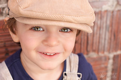 Flirt (Photos By Michi) Tags: 2yearold 23years adorable blueeyes boy child children cute dapper grin happy hat hazeleyes kid portrait smile toddler