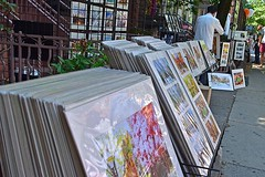 Stacking Prints (AntyDiluvian) Tags: boston massachusetts backbay street newburystreet vendor art prints bostonscenes scenesofboston rack sidewalk