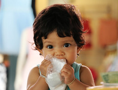 Ko Samui, Thailand (Gijs de Blauw) Tags: food baby color cute asian thailand kid asia child little small culture eat thai bite chew