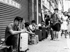 Tired Chinese shoppers (TomasCP82) Tags: street 2 people shopping olympus hong kong tired f18 mongkok omd 25mm