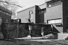 Curtain Fence (geowelch) Tags: toronto blackwhite 35mmfilm urbanlandscape pentaxmx libertyvillage urbanfragments xp2super400 pentaxm50mmf17 plustekopticfilm7400