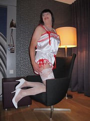 Mischief (Paula Satijn) Tags: sexy hot teddy satin silk shiny gurl tgirl transvestite playsuit stockings lace bow white red happy smile legs pumps heels highheels girl stockingtops