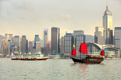Duk Ling Ride (Patrick Foto ;)) Tags: china city trip travel cruise red sea vacation hk building classic tourism water ferry architecture sailboat skyscraper port landscape asian hongkong coast harbor boat town wooden asia ship cityscape cloudy space flag traditional famous sightseeing chinese vessel victoria tourist historic hong kong transportation highrise sail destination mast concept rise kowloon copy duklingride