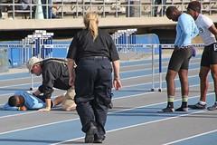D125079A (RobHelfman) Tags: sports losangeles track injury highschool crenshaw prelims citysection